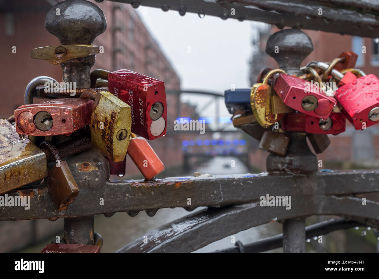 Love locks on a bridge at Hafen City, Hamburg, Germany - Stock Image