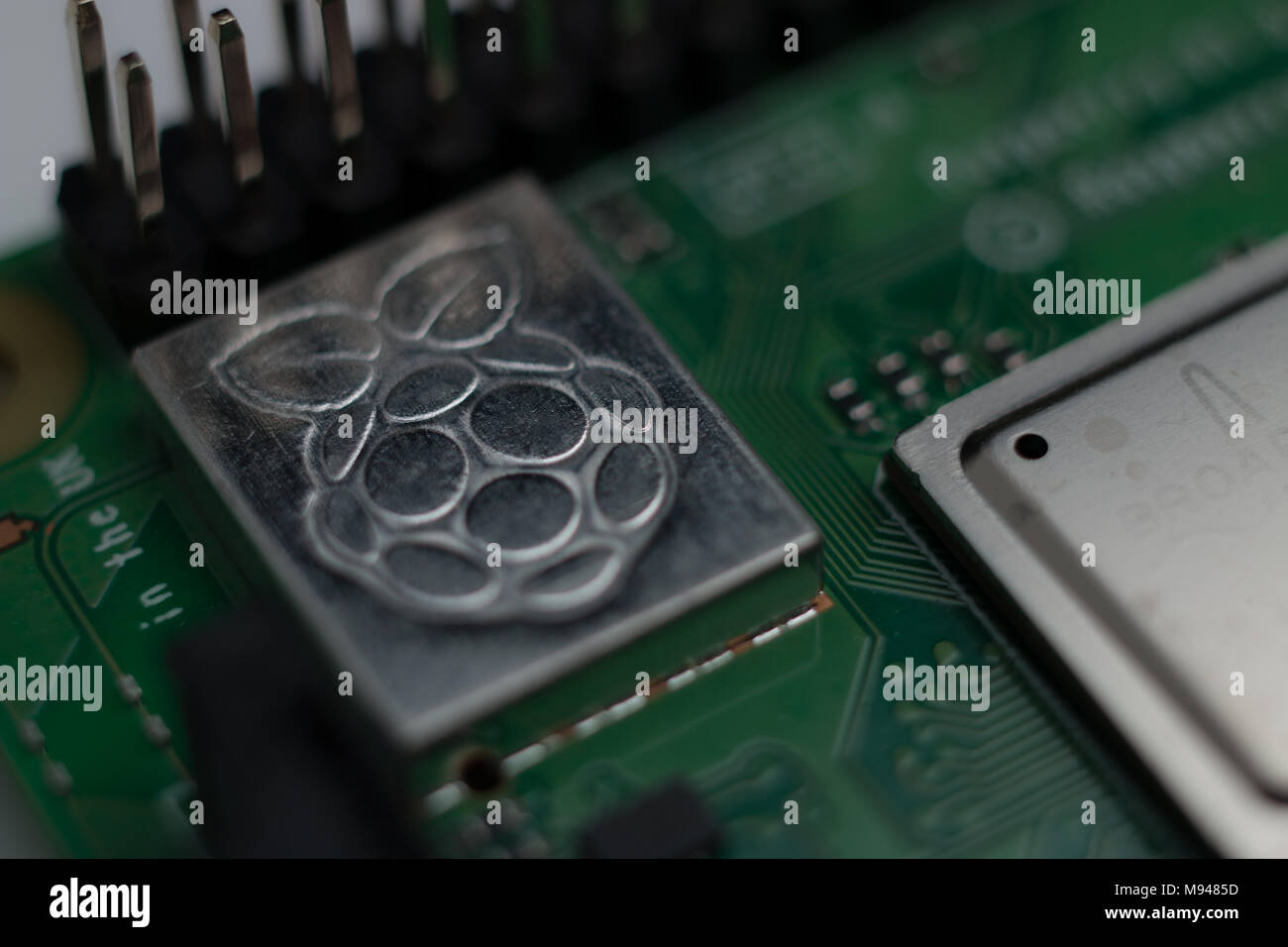 Close up of the Raspberry Pi logo etched on a Pi 3 B+ - Stock Image