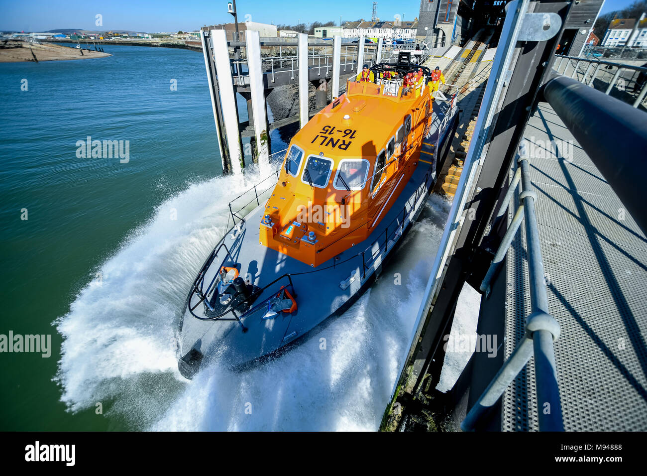 RNLI Rescue vessel launches into the sea from its base in Shoreham by Sea, Sussex, UK. - Stock Image
