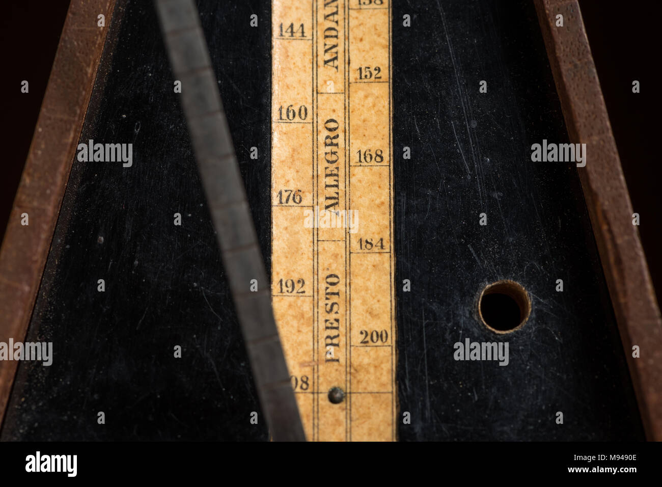 Detail of an old mechanic musical metronome, scale showing the various tempos - Stock Image