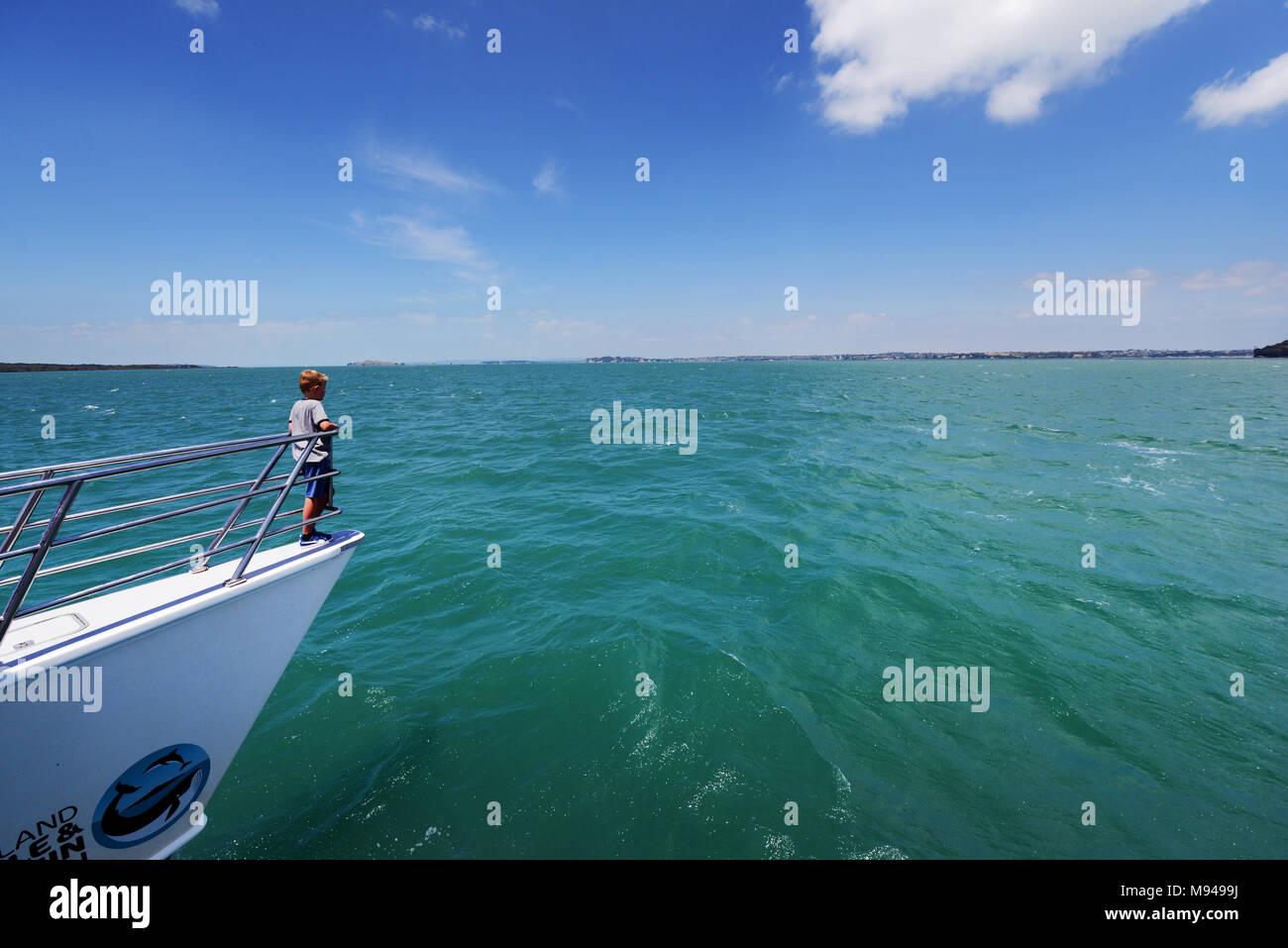 Tourist enjoying themselves on the Auckland whale & dolphin safari - Stock Image