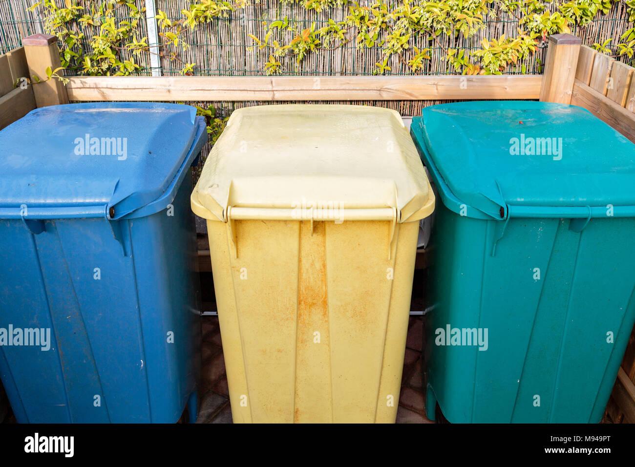Three types of waste separation tanks on the beach in Italy. Hazardous waste, Dry garbage, wet waste. Environmental care Organize trash bins to separate for easy management. Environmental care - Stock Image