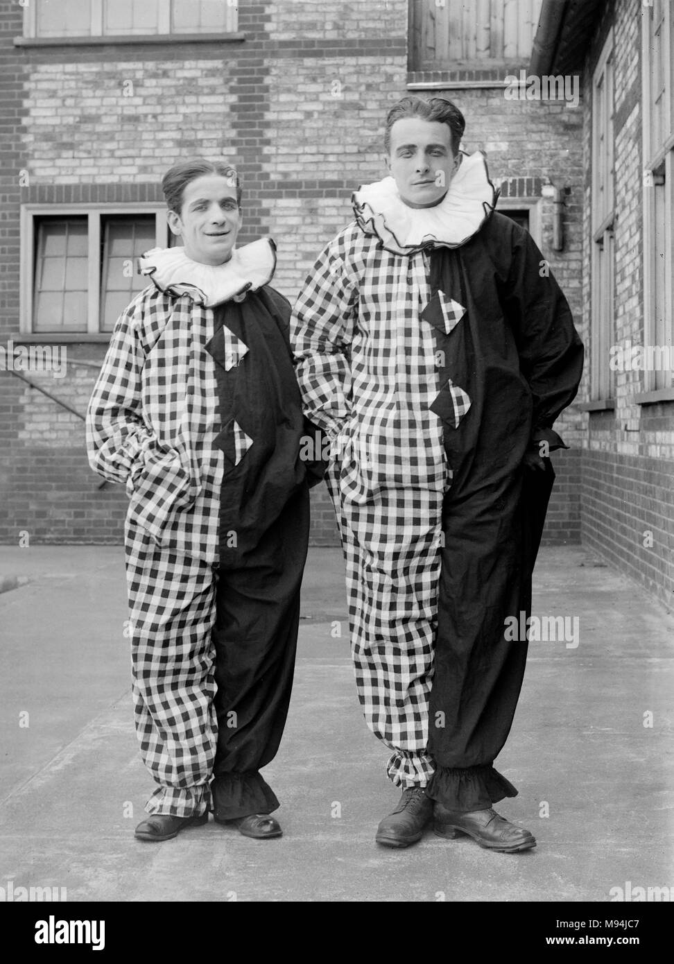 Two clowns of the Pierrot style pose in the UK, ca. 1920. - Stock Image