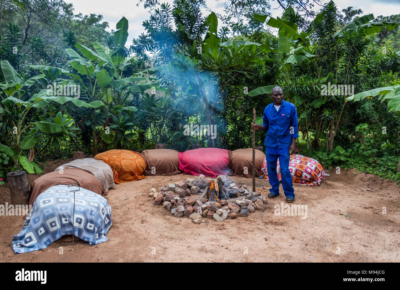 african man with a campfire - Stock Image