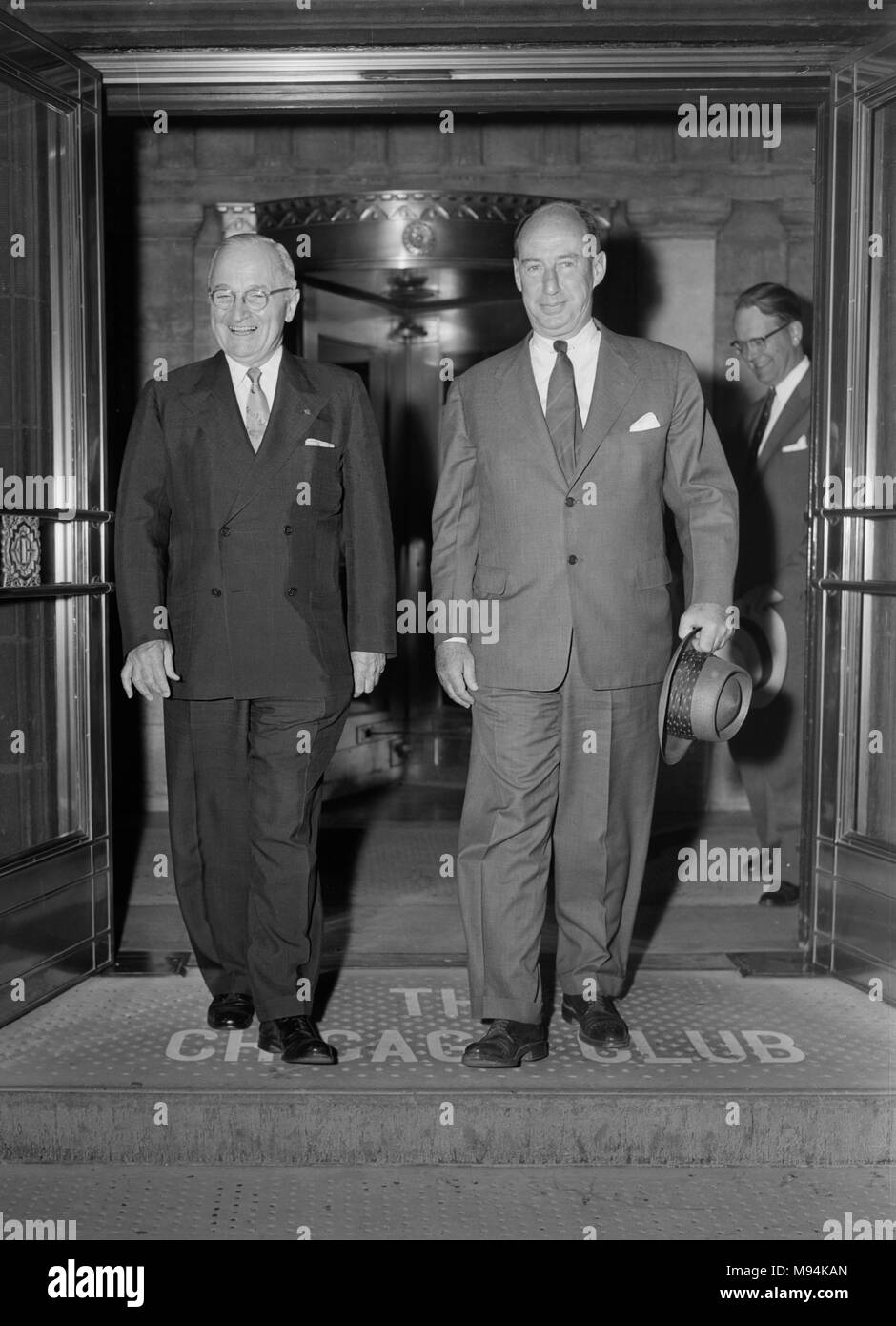 Former President Harry S. Truman and Presidential candidate Adlai Stevenson exit The Chicago Club after an appearance together in 1956. Stock Photo