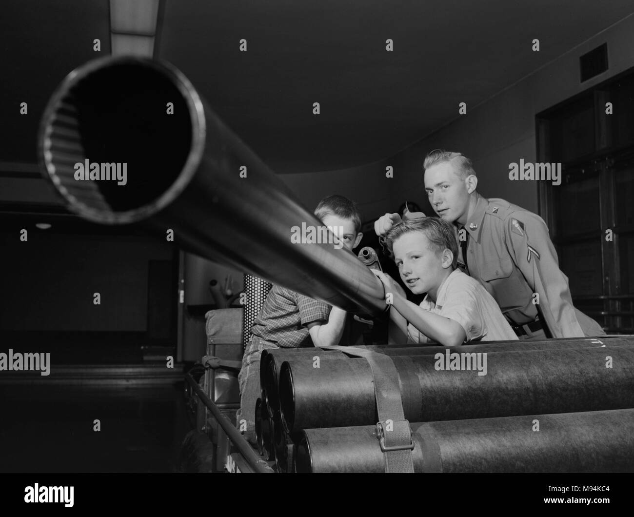 Three boys examine a 106 mm recoilless rifle at an Army exhibit at the Museum of Science and Industry in Chicago in 1958. - Stock Image