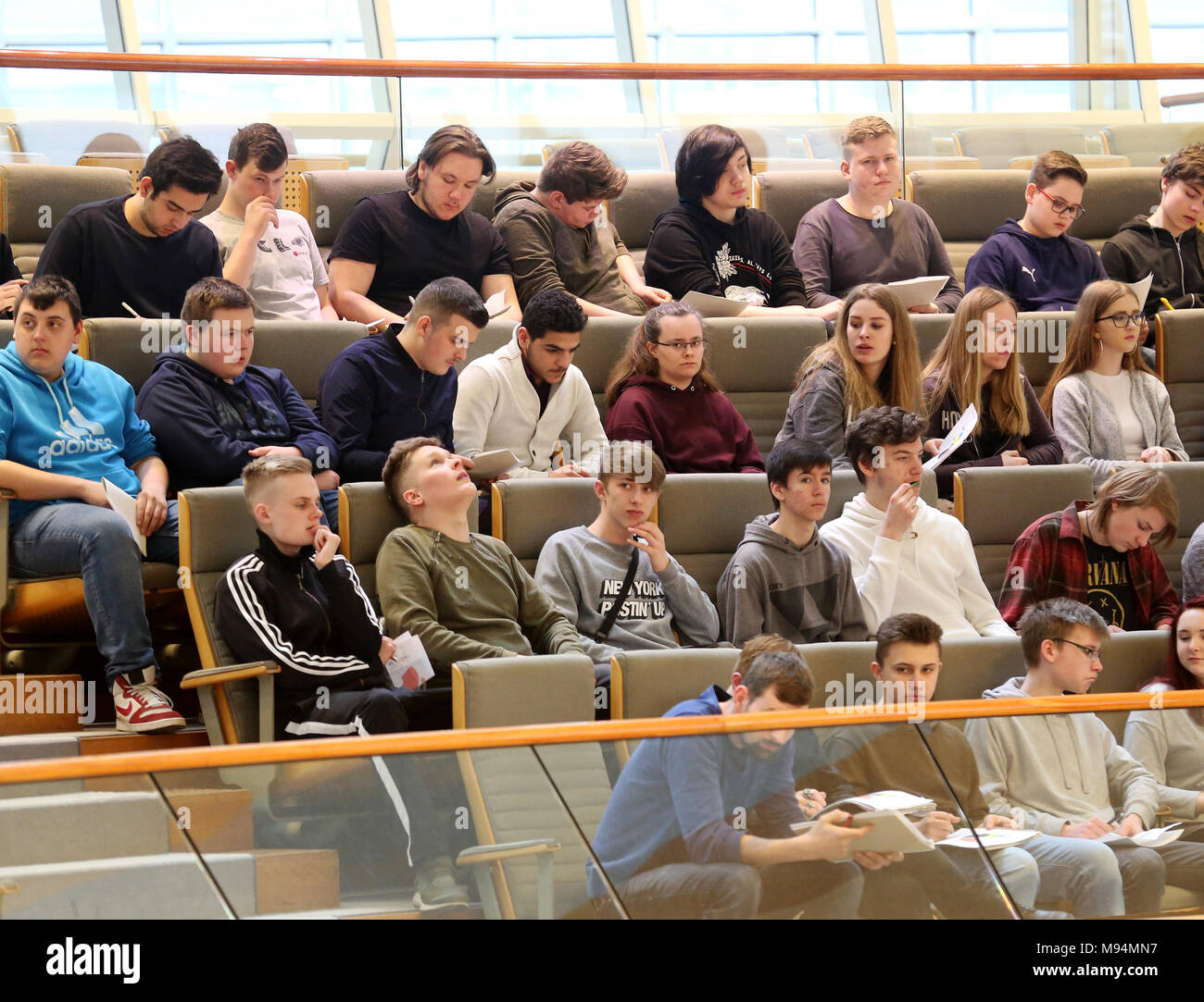 22 March 2018, Germany, Duesseldorf: Teenagers following the speech of North Rhine Westphalia's (NRW) Minister for Schools, Yvonne Gebauer, of the Free Democratic Party (FDP) at the session of the north rhine-westphalian state parliament. Topics of the session are rules for the state's art foundation and the introduction of a legislation amendment in schools for nine years of school until A-levels. Photo: Roland Weihrauch/dpa - Stock Image