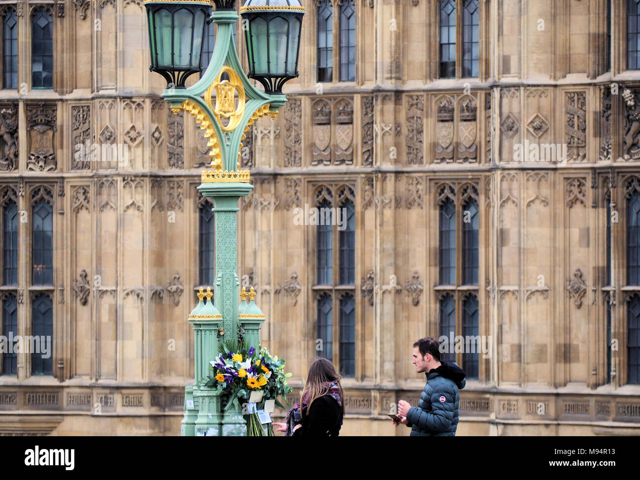 London, UK. 22nd Mar, 2018. The one year anniversary of the Westminster Bridge Attack is marked by flower tributes and solidarity messages on Westminster Bridge and on Parliament Square. © Brian Minkoff/Alamy Live News - Stock Image