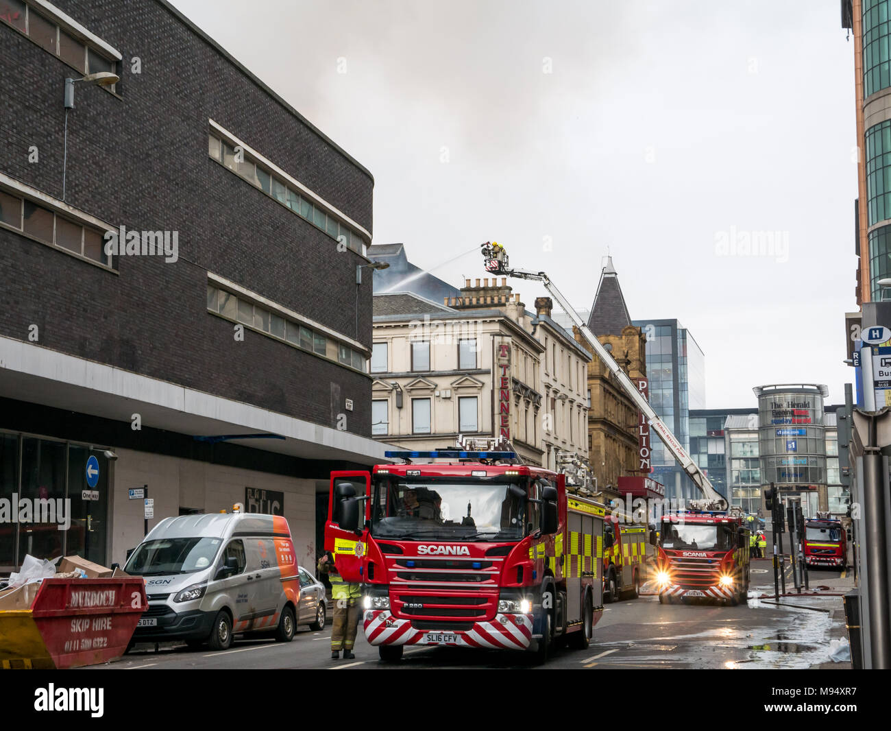 Renfield Street, Glasgow, Scotland, United Kingdom, 22nd March 2018. A major fire involving multiple buildings closes streets in central Glasgow.  Firefighters and fire engines battle the blaze with high level ladders - Stock Image