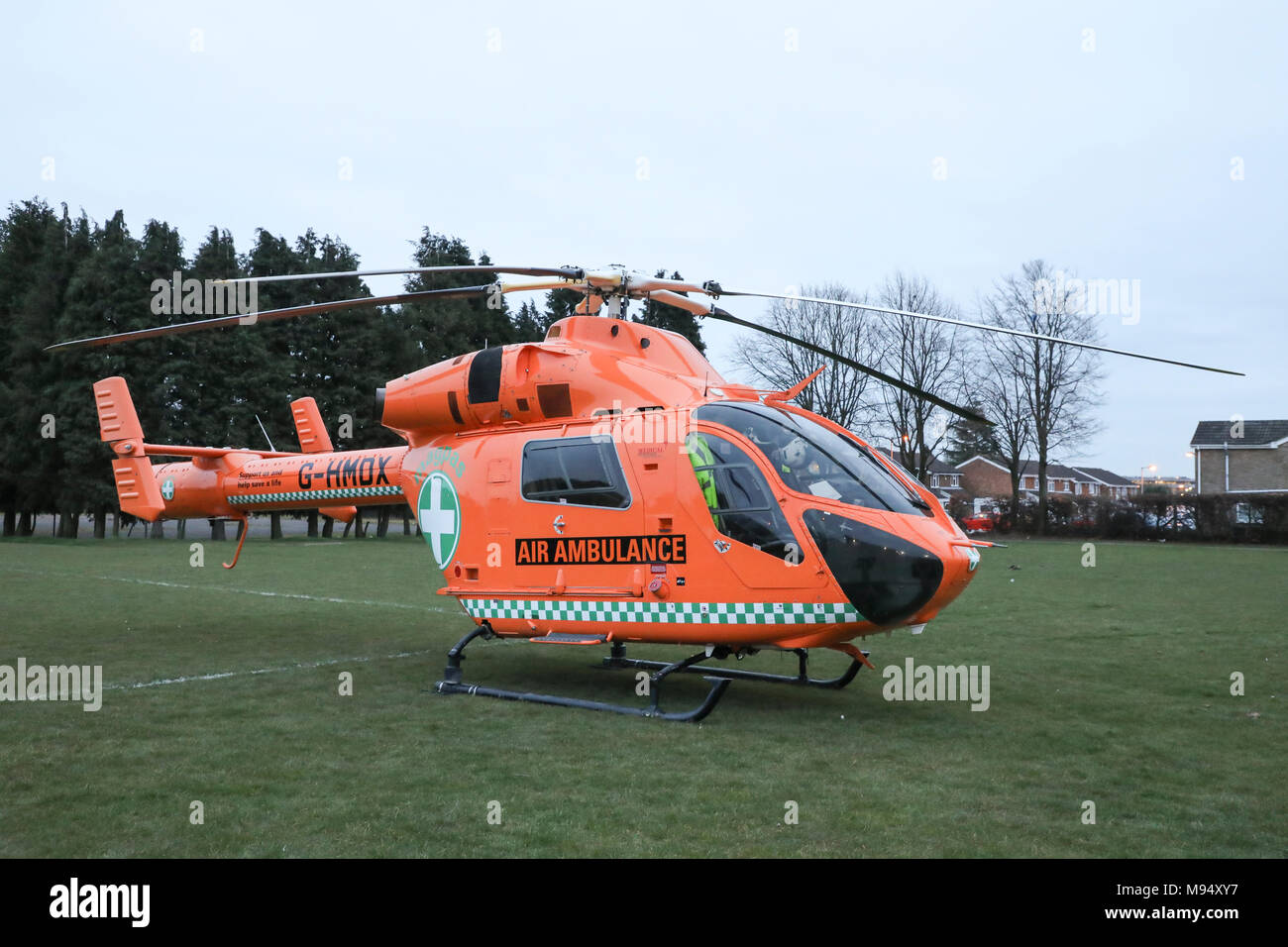 Luton, UK. 22nd Mar, 2018. Paramedics respond to an emergency call in Luton, Bedfordshire and land their MD-900 Air Ambulance helicopter at Crawley Green Park. Credit: Nick Whittle/Alamy Live News - Stock Image