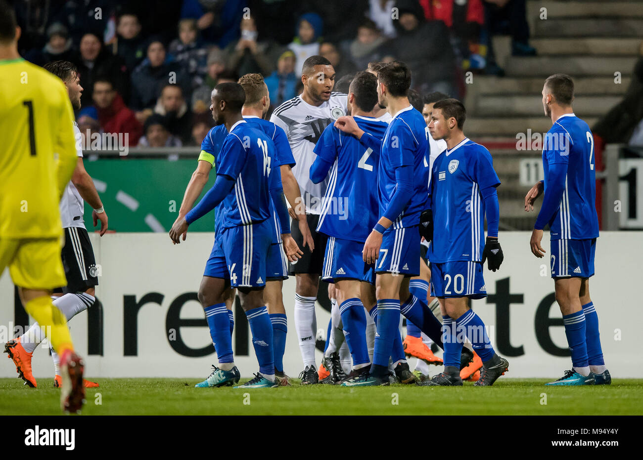 Braunschweig, Deutschland. 22nd Mar, 2018. Gerangel zwischen Spieler beider Mannschaften (u.a. with Jonathan Tah) GES/ Fussball/ U 21: Germany - Israel, 22.03.2018 -- Football/ Soccer Under 21: Deutschcland vs Israel, Braunschweig, March 22, 2018 -- |usage worldwide Credit: dpa/Alamy Live News Stock Photo