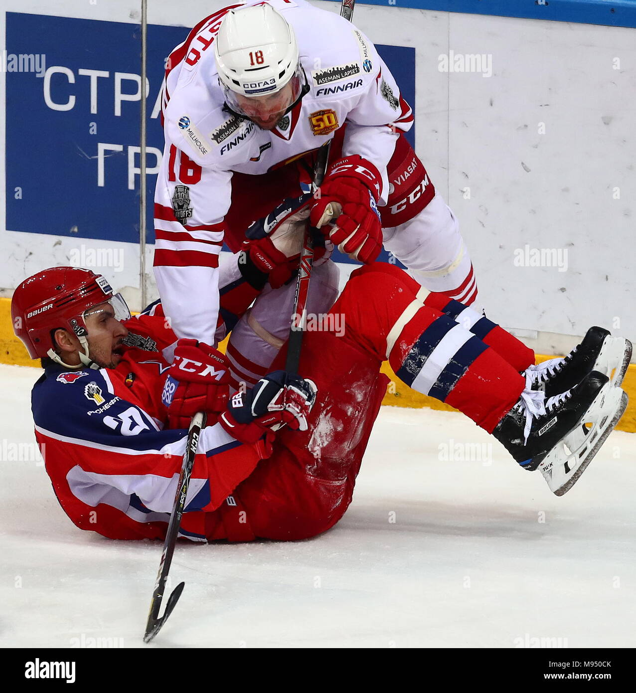 Moscow, Russia. 22nd Mar, 2018. MOSCOW, RUSSIA - MARCH 22, 2018: CSKA Moscow's Kirill Petrov (L) and Jokerit Helsinki's Sami Lepisto in their 2017/18 KHL Western Conference semifinal playoff ice hockey match at CSKA Ice Palace. Stanislav Krasilnikov/TASS Credit: ITAR-TASS News Agency/Alamy Live News - Stock Image
