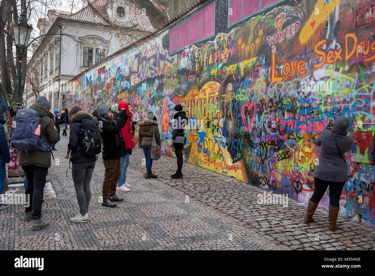 The John Lennon Memorial Wall in Velkoprevorske namesti(Grand Priory Square), Malá Strana, on 18th March, 2018, in Prague, the Czech Republic. The Lennon Wall or John Lennon Wall is a wall in Prague, Czech Republic. Once a normal wall, since the 1980s it has been filled with John Lennon-inspired graffiti and pieces of lyrics from Beatles' songs. In 1988, the wall was a source of irritation for the communist regime of Gustáv Husák. Young Czechs would write grievances on the wall and in a report of the time this led to a clash between hundreds of students and security police on the nearby Charle - Stock Image