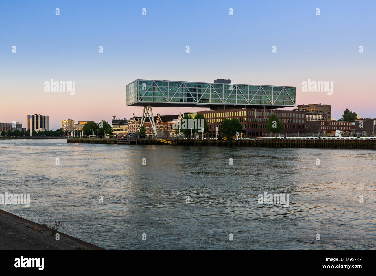 ROTTERDAM, NETHERLANDS - MAY 25, 2017: Exterior view of the promenade from the Prins Hendrikkade Street at evening with a view to the Maas River on Ma - Stock Image