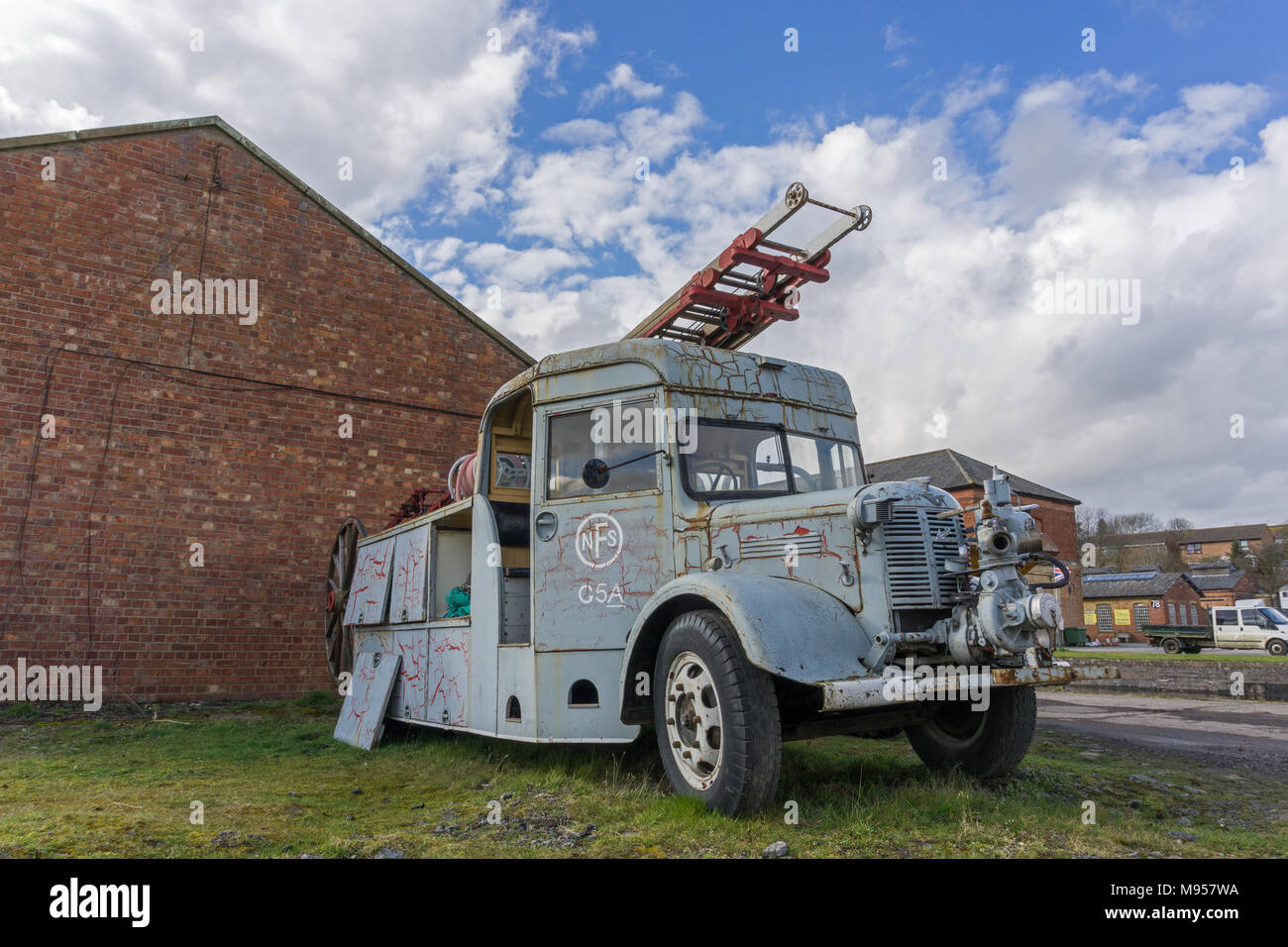 Battered old fire engine at the former Royal Ordnance Depot, Weedon, Northamptonshire, UK - Stock Image