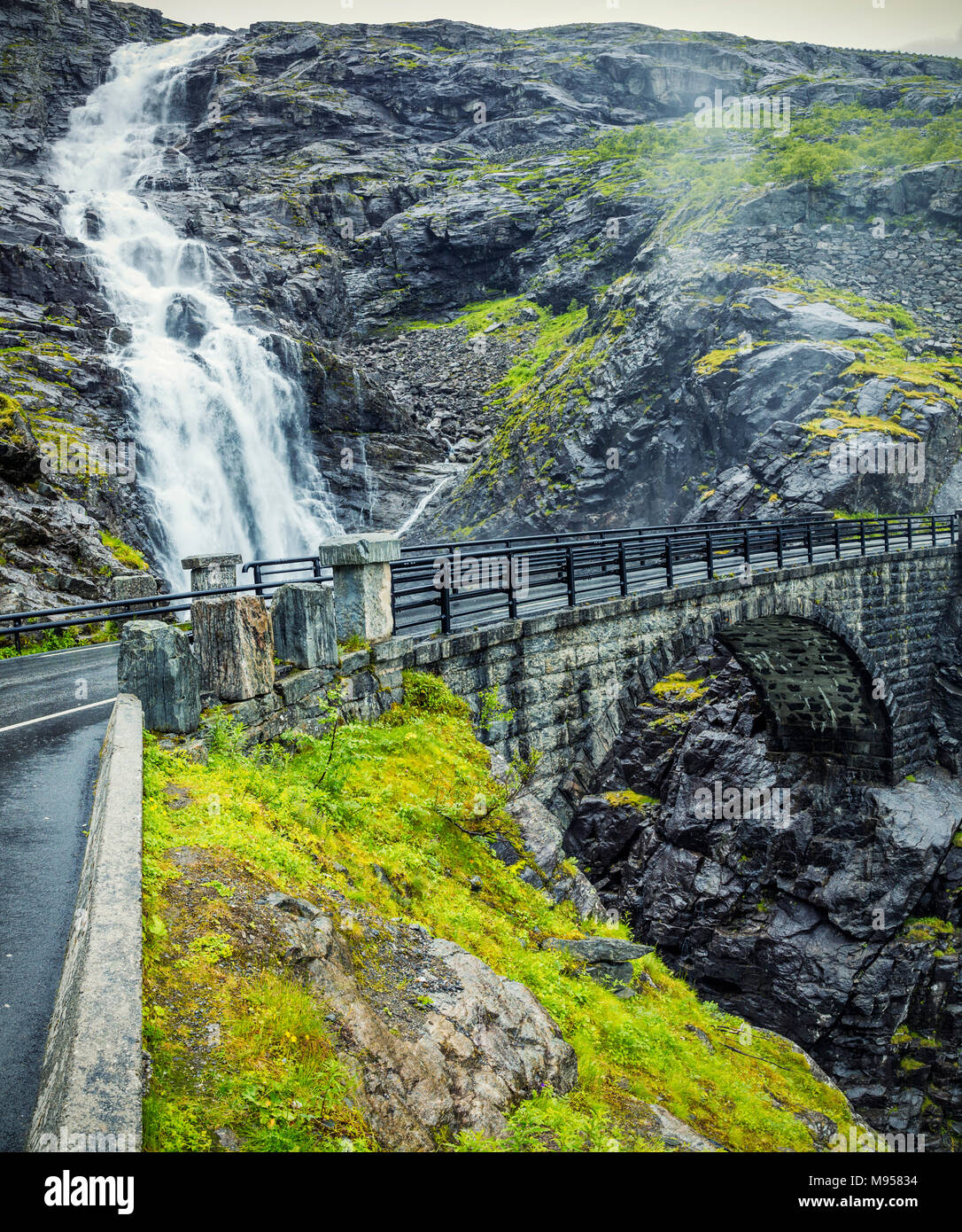 View On Bridge and Waterfall In Troll Road, Norway - Stock Image