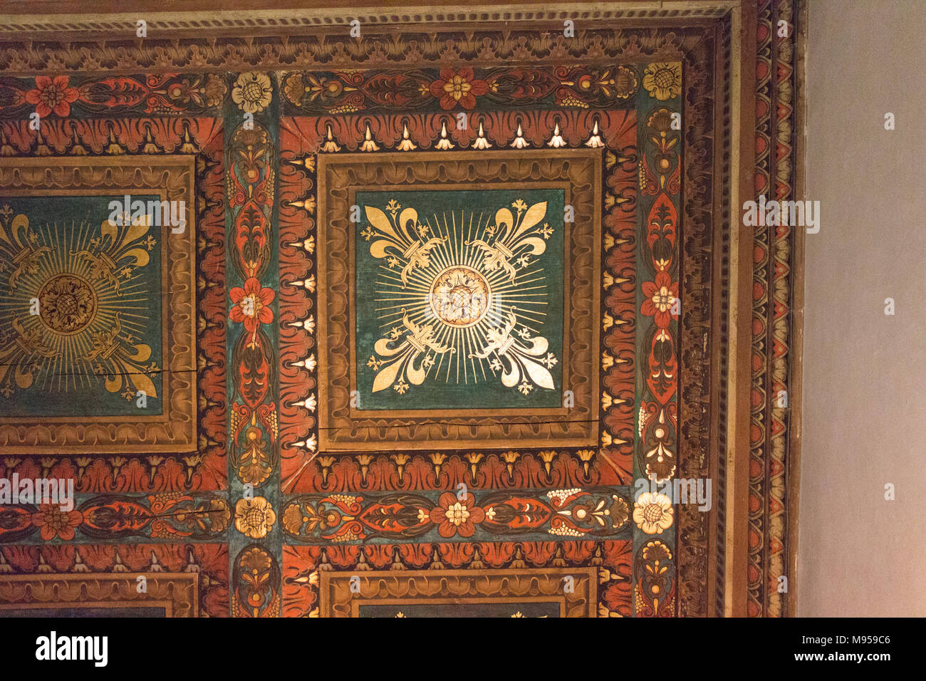 Italy, Florence - May 18 2017: the view of the painted wooden ceiling fragment inside the medieval Palazzo Vecchio on May 18 2017 in Florence, Italy. Stock Photo