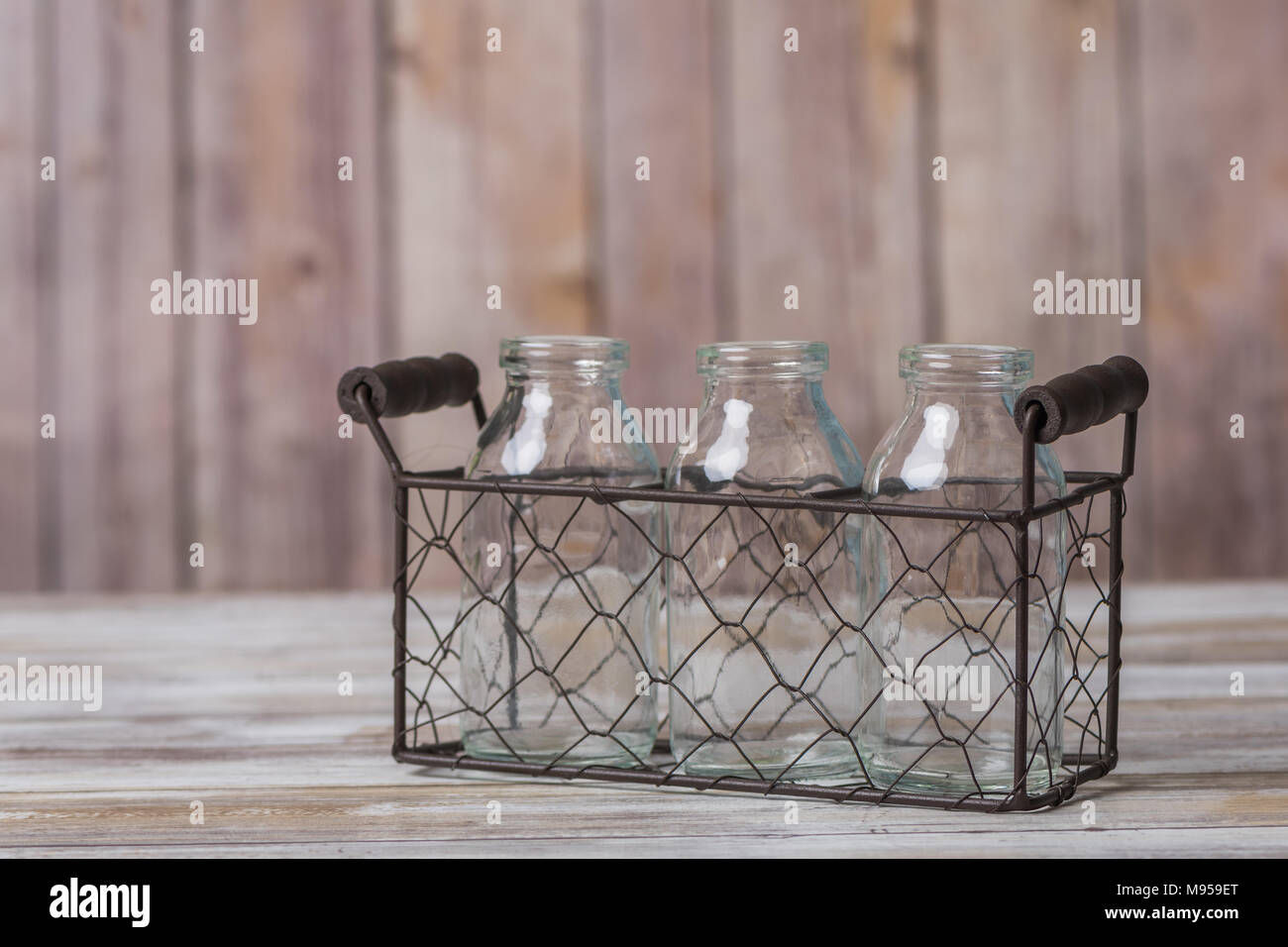 Vintage milk bottles in a wire basket carrier Stock Photo: 177752816 ...