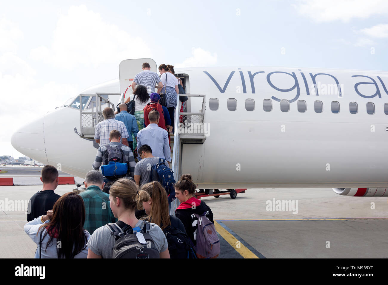 Passengers boarding Virgin Australian Boeing 737 at Sydney Kingsford Smith Airport, Mascot, Sydney, New South Wales, Australia - Stock Image