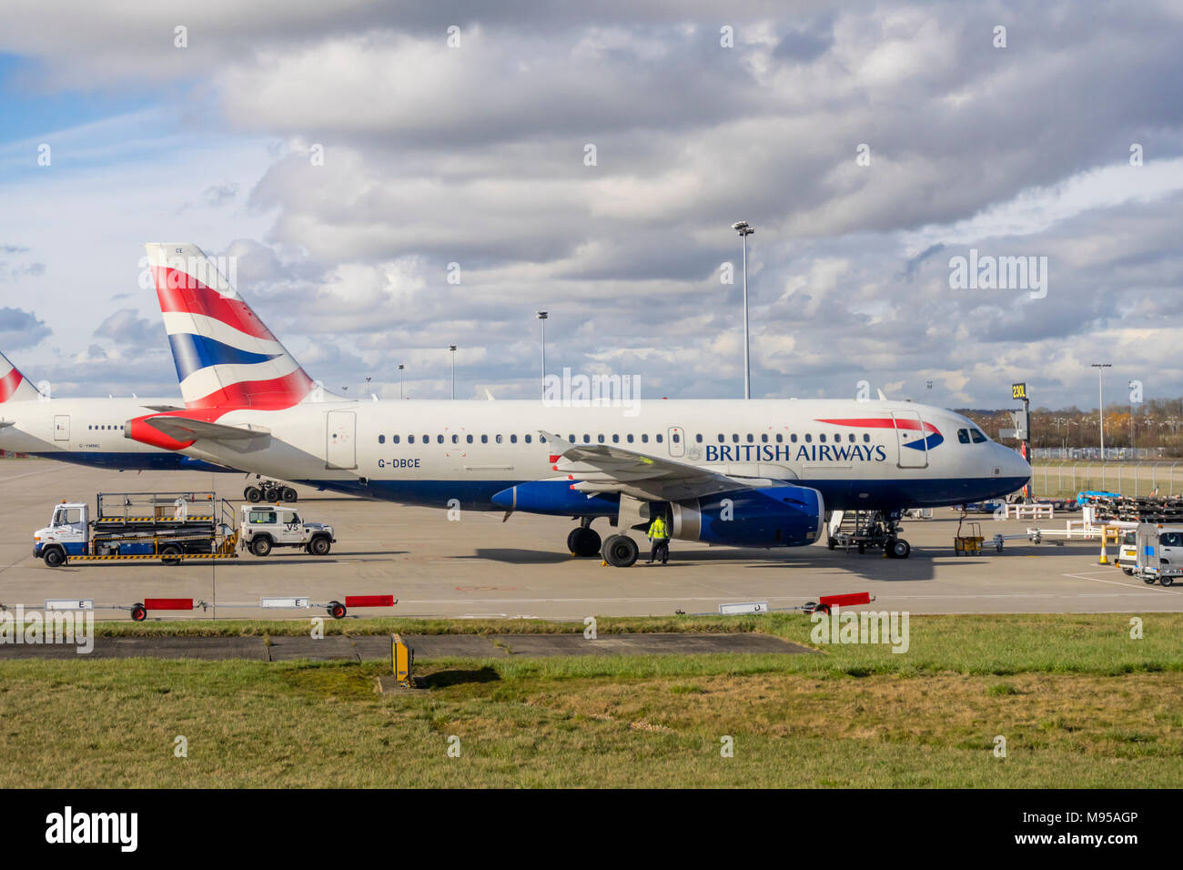 A stationary British Airways airplane of the Airbus A319 type  parked at London Gatwick Airport in 2018, England, UK - Stock Image