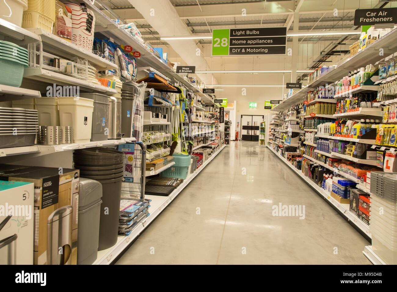 Light bulbs, diy,motoring,home appliances for sale on full shelves in an Asda supermarket. - Stock Image
