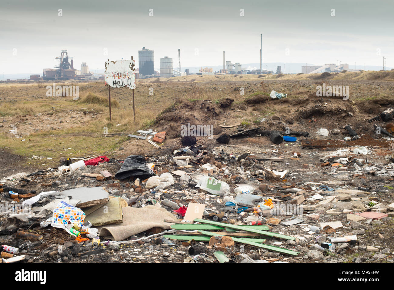 Fly tipping on industrial wasteland, South Gare, Redcar, Teesside. UK - Stock Image