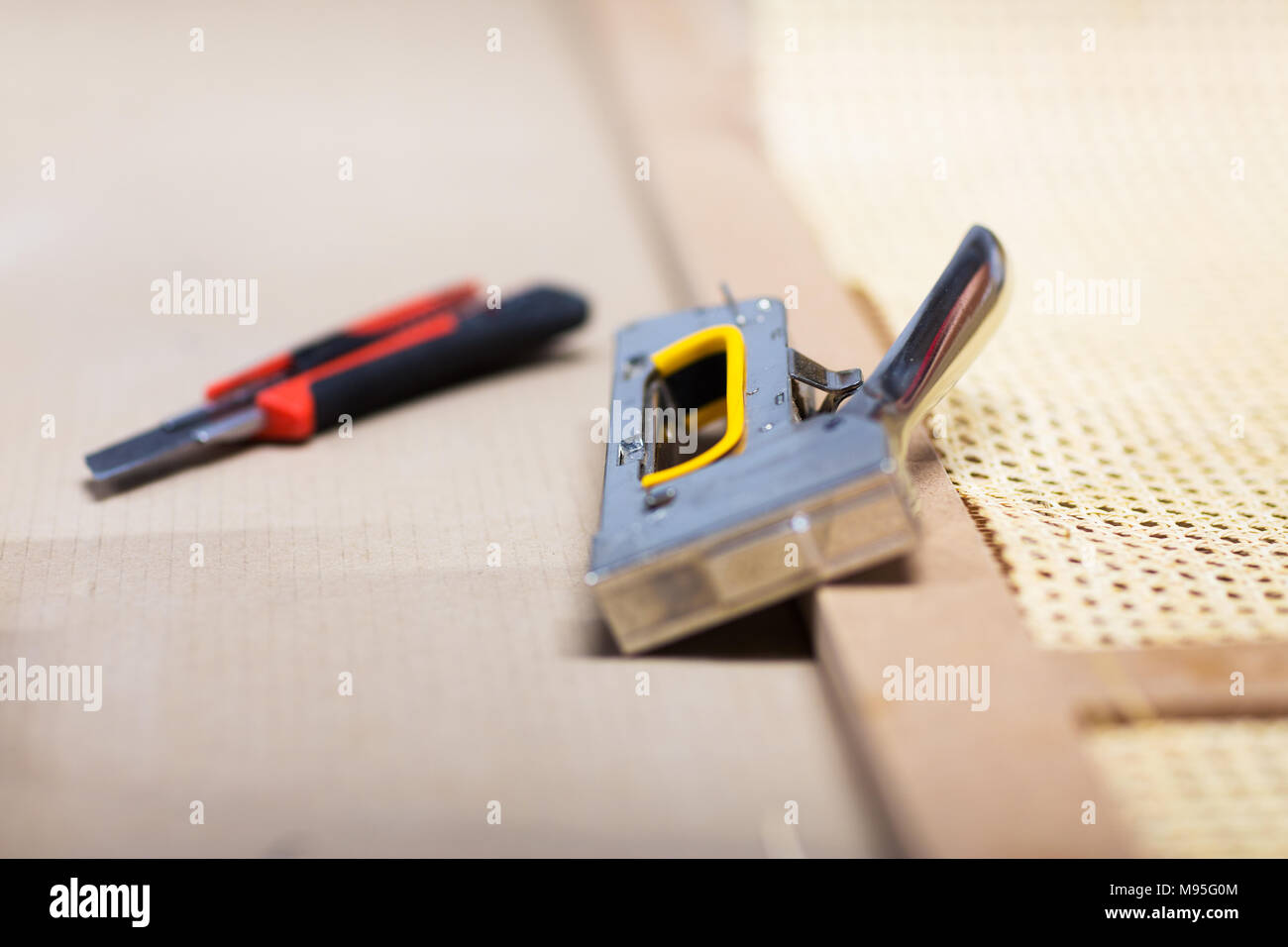 Staple Gun And Cutter Knife With Furniture Item   Stock Image