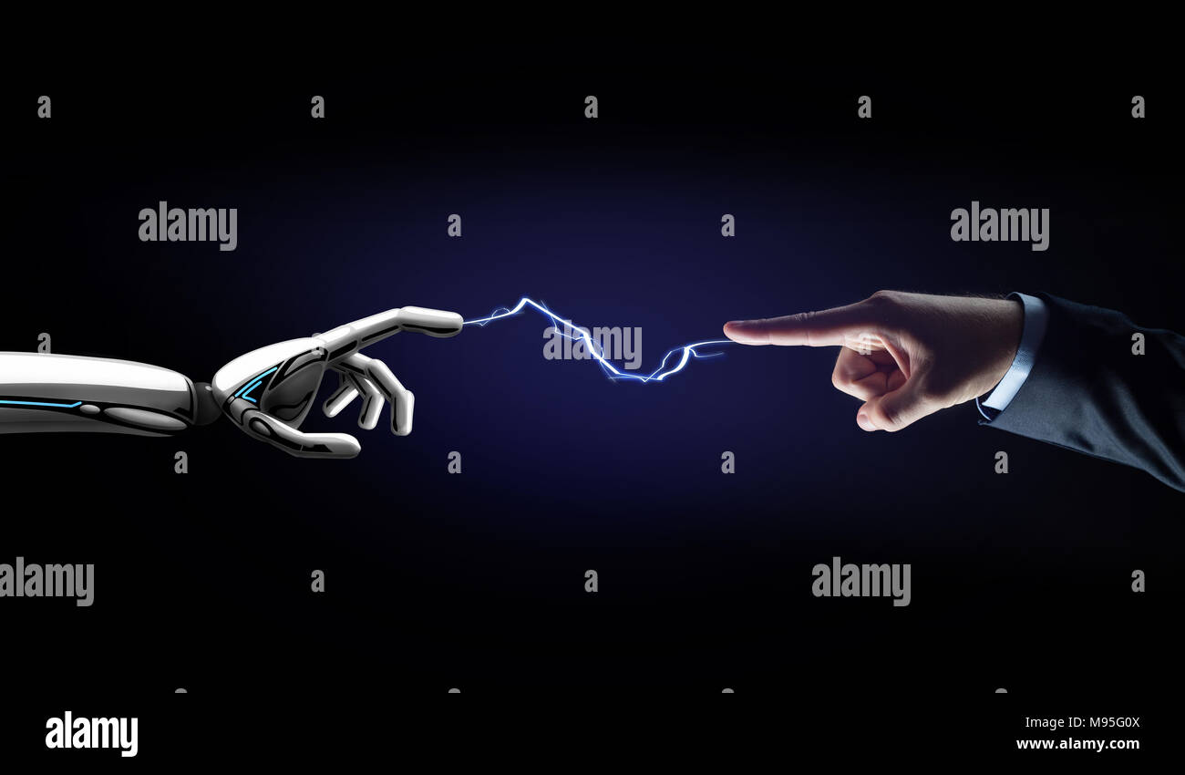 robot and human hand connected by lightning Stock Photo