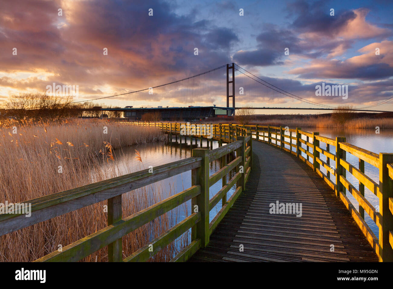 The Water's Edge Country Park in Barton-upon-Humber, North Lincolnshire, UK. The Humber Bridge towers over the park's Visitor Centre. - Stock Image
