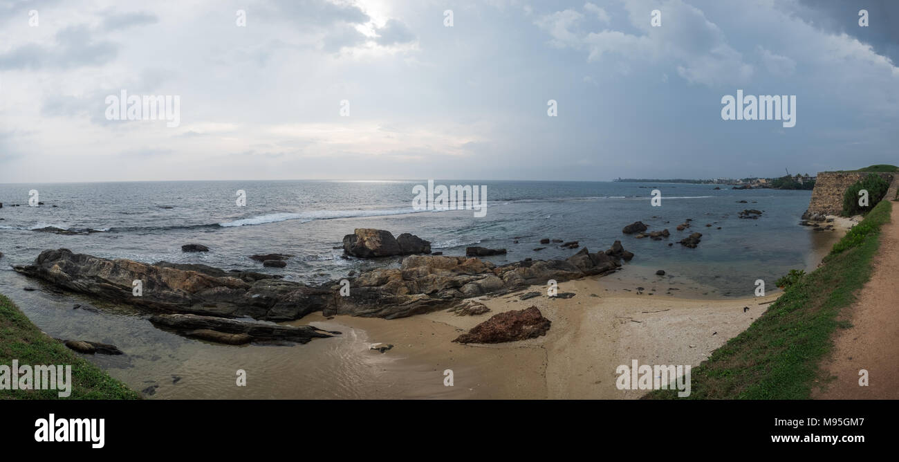 Landscape view on rocky coast ocean in Galle Srilanka in cloudy weather - Stock Image