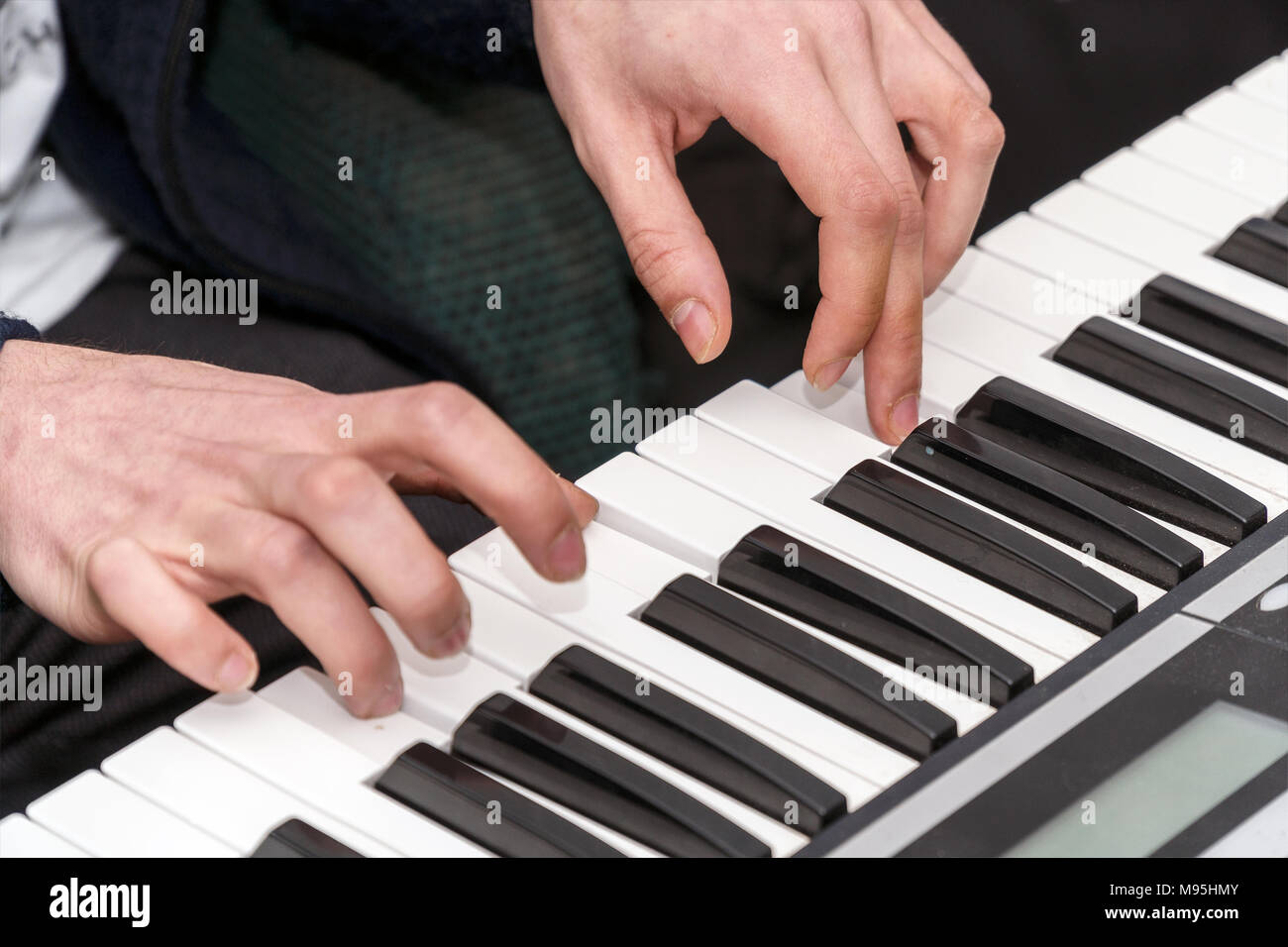 Hands of a pianist. Plays on the synthesizer - Stock Image