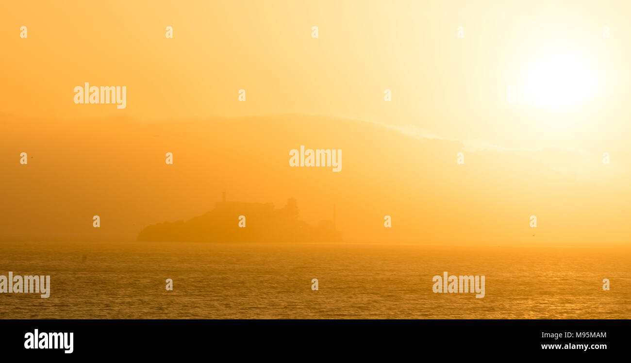 Only the islands outline is visable in this horizontal composition with Alcatraz Island - Stock Image