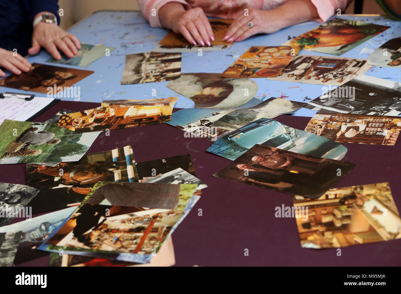A craft club doing some crafting with old photographs in Bognor Regis, West Sussex, UK. Stock Photo