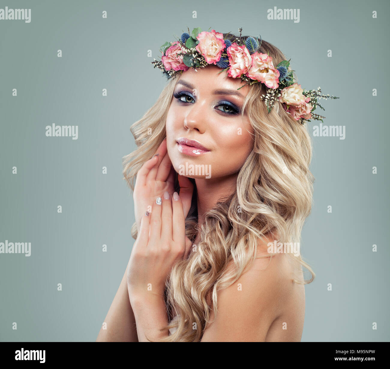 Spring beauty beautiful woman with flowers blonde permed hairstyle spring beauty beautiful woman with flowers blonde permed hairstyle and healthy skin on blue background izmirmasajfo