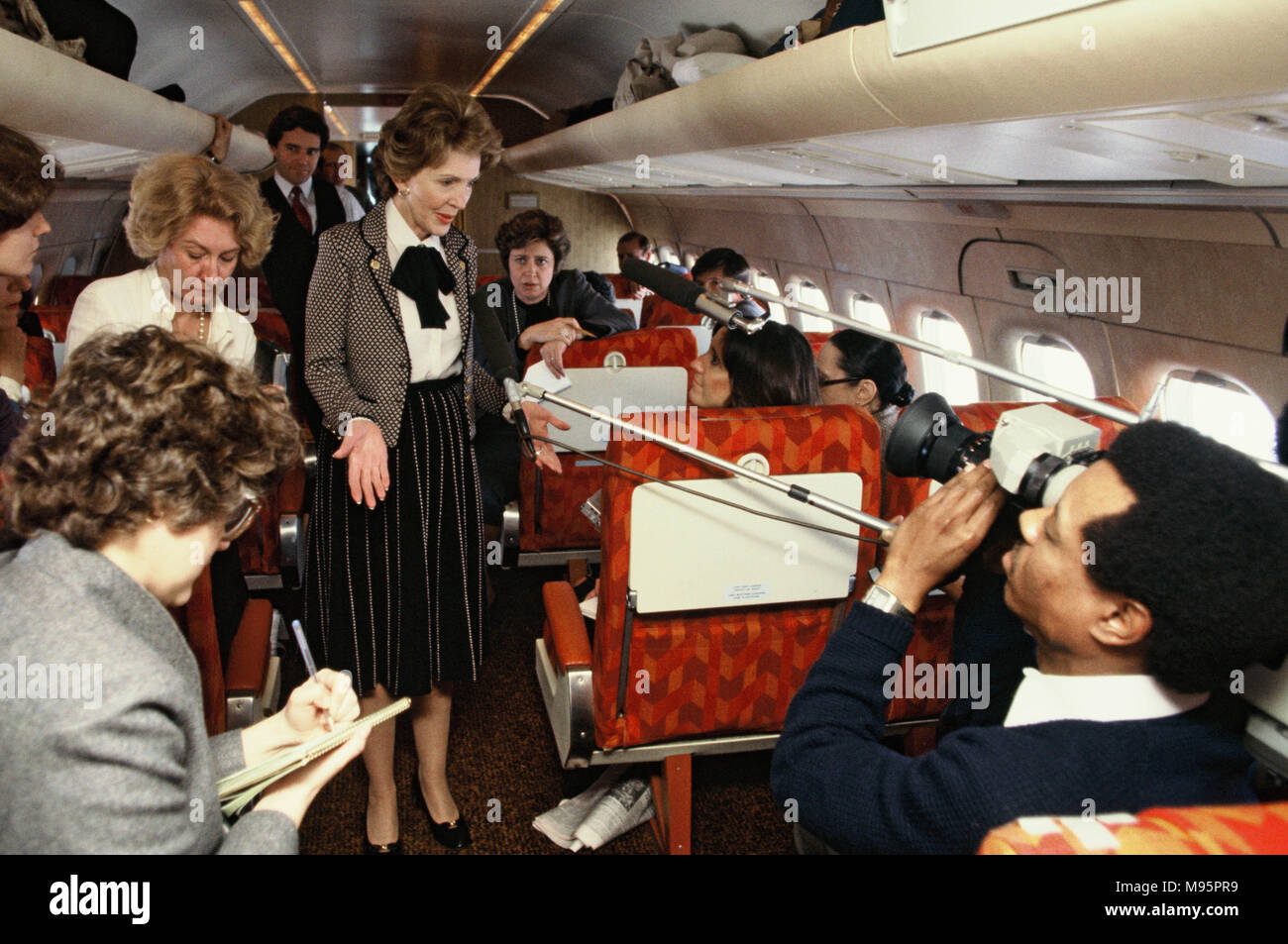 "First Lady Nancy Reagan talking to press on the plane to  Dallas, Texas in February 1982.  This is part of an anti drug trip, ""Just Say No"" for the First Lady  Photograph by Dennis Brack - Stock Image"