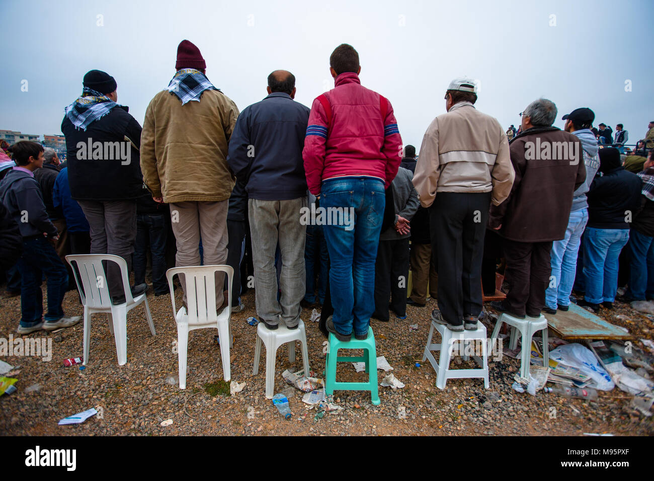 A long shot encapsulating a crowd watching camel wrestling in Turkey. - Stock Image