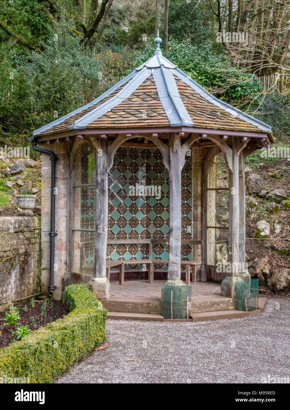 Summer house with green Victorian tiled walls in the corner of the parterre garden at Tyntesfield in Somerset UK - Stock Image
