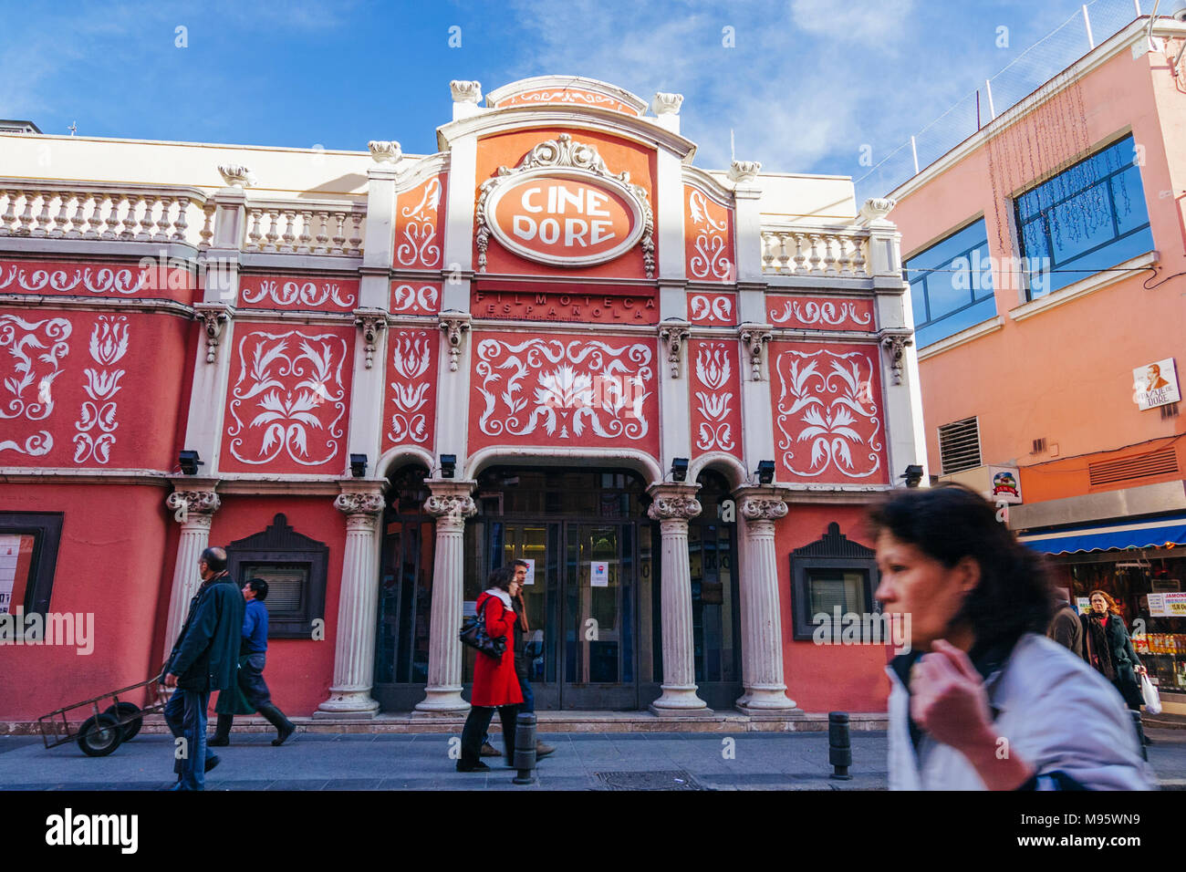 Madrid, Spain : People walk past cine Doré, the cinema of the Spanish Cinemathèque (Filmoteca Española) and featured by Pedro Almodóvar in Talk to Her - Stock Image