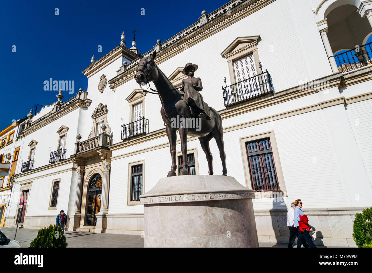 Seville, Andalusia, Spain : People walk past the equestrian monument to the Countess of Barcelona by sculptor Miguel García Delgado by the headquarter - Stock Image