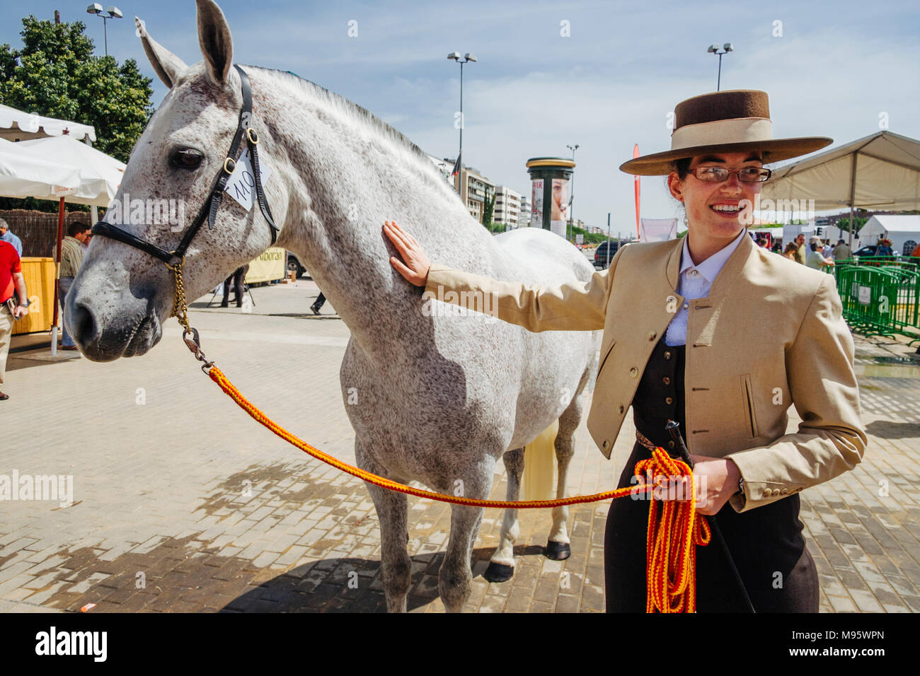 Cordoba, Andalusia, Spain : Andalusian horsewoman and thoroughbred mare at the Cordoba Horse Fair. - Stock Image