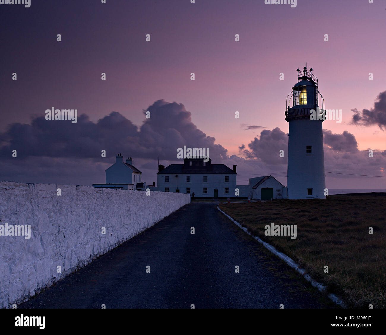 Lighthouse at Loop Head on Ireland's Atlantic west coast at dusk, County Clare - Stock Image