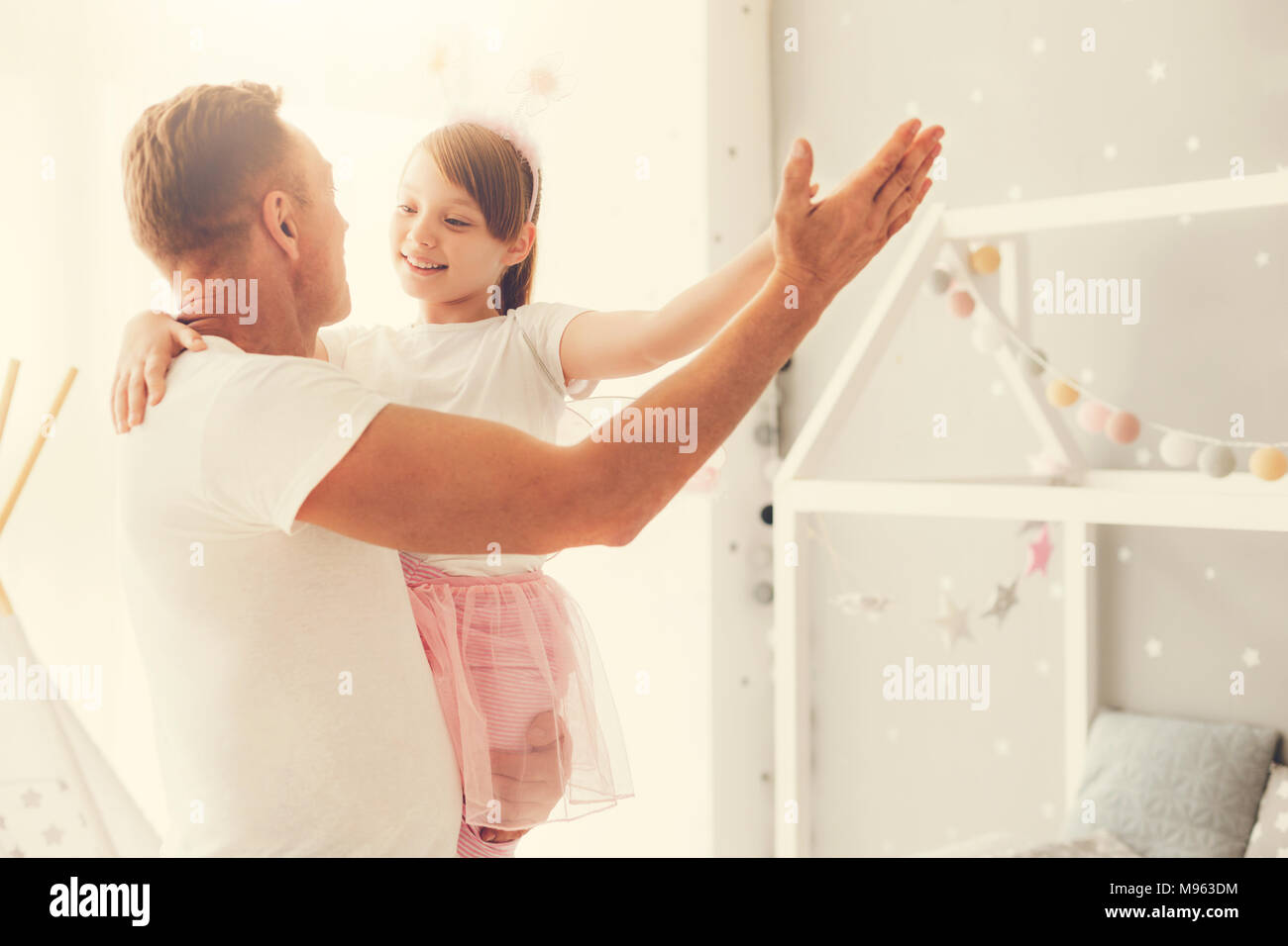 Cute happy girl dancing with her father - Stock Image