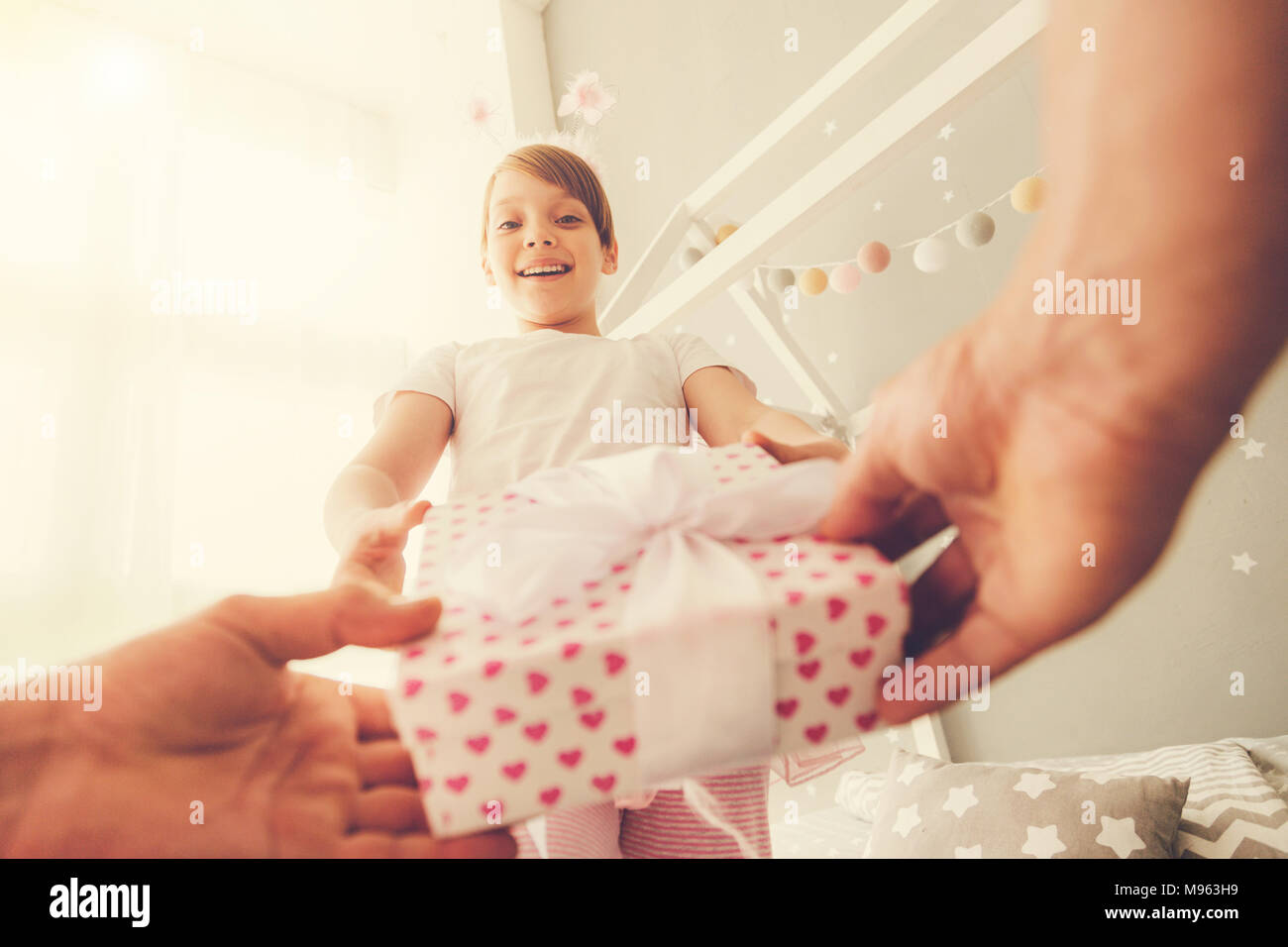 Nice happy girl receiving a present - Stock Image