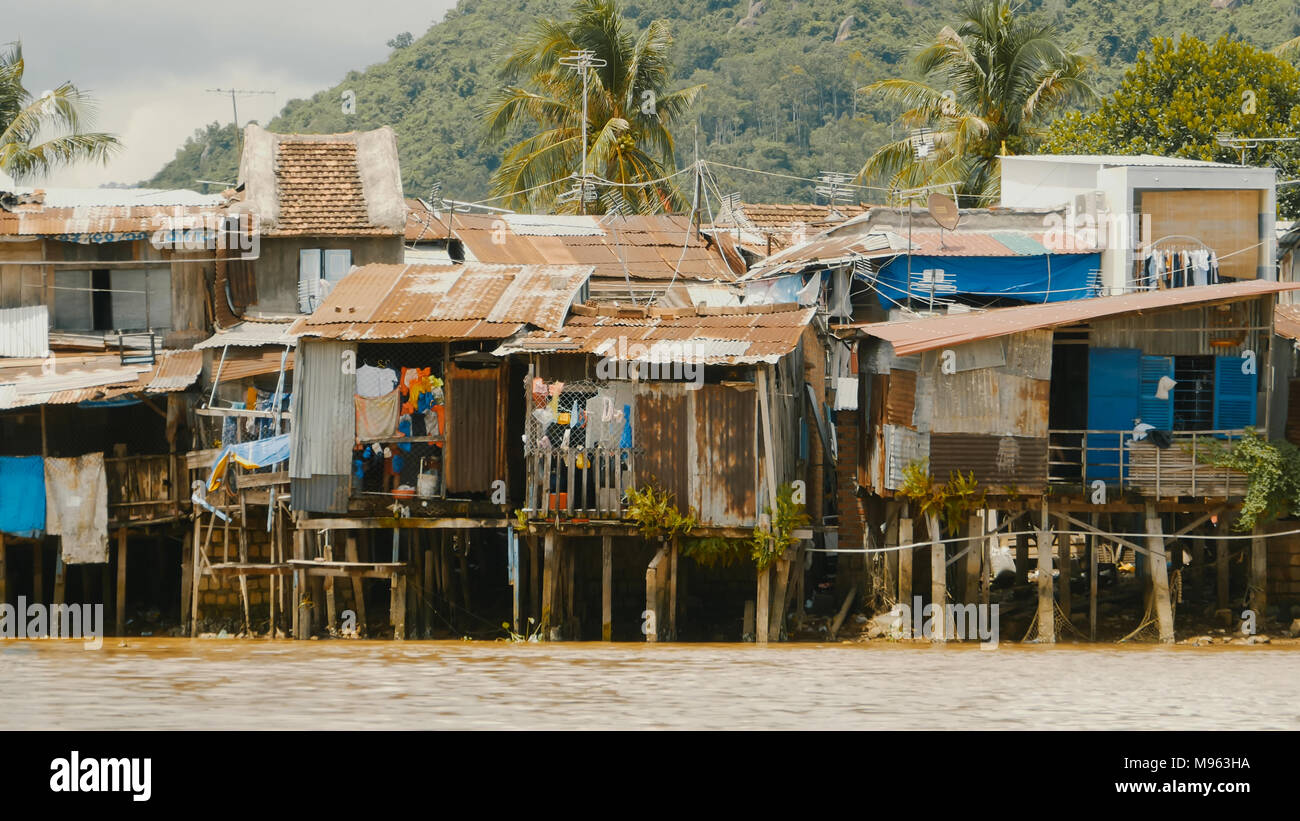 Slums in Nha Trang. Houses on the river. - Stock Image