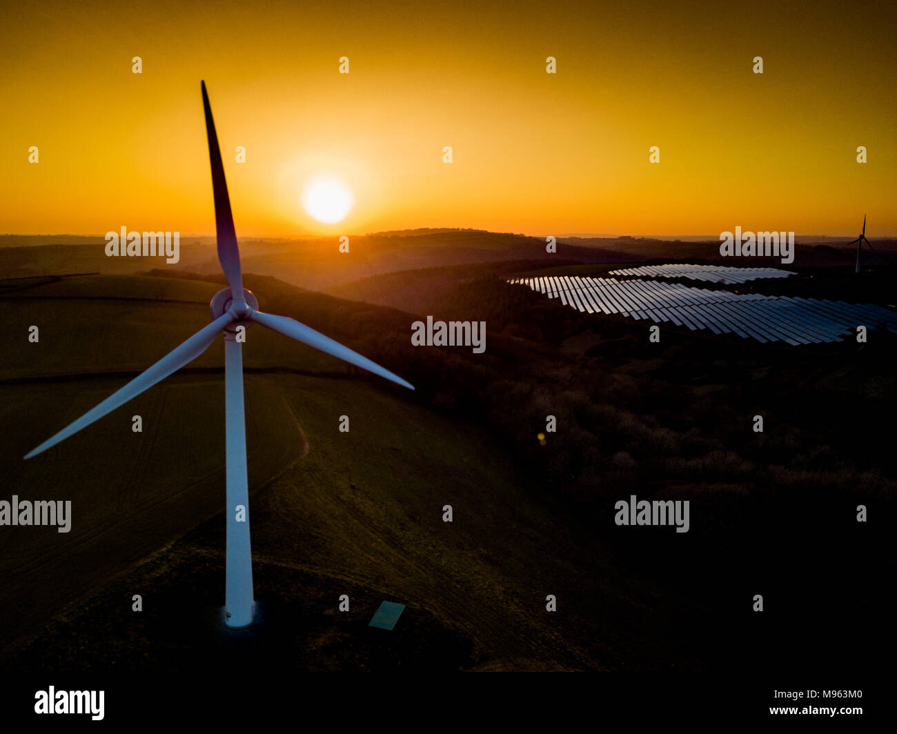A turbine used to generate power is silhouetted by the sunset in Saltash, Cornwall - Stock Image