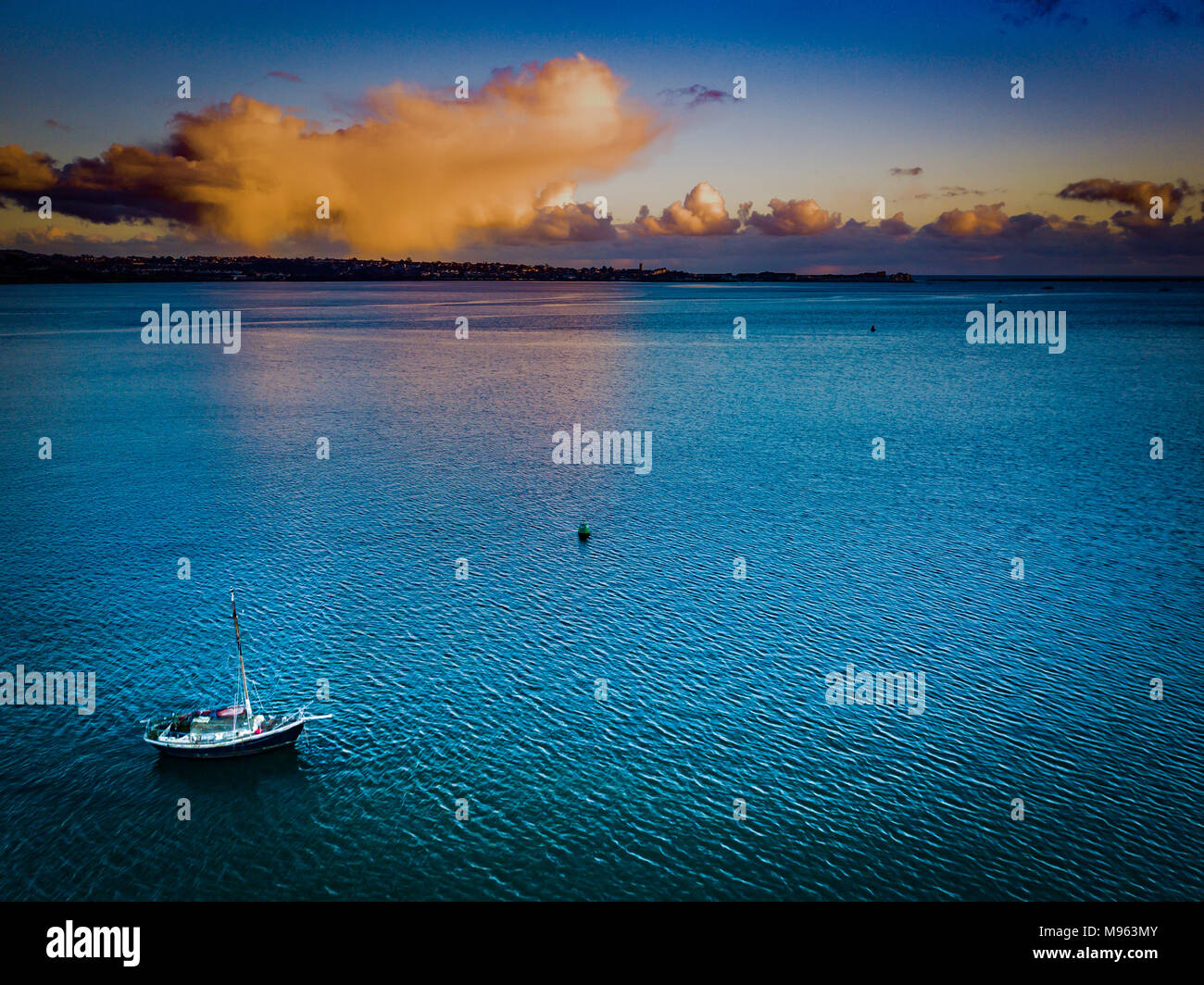 An aerial view of a solitary boat on the River Exe near Starcross in Devon, UK - Stock Image