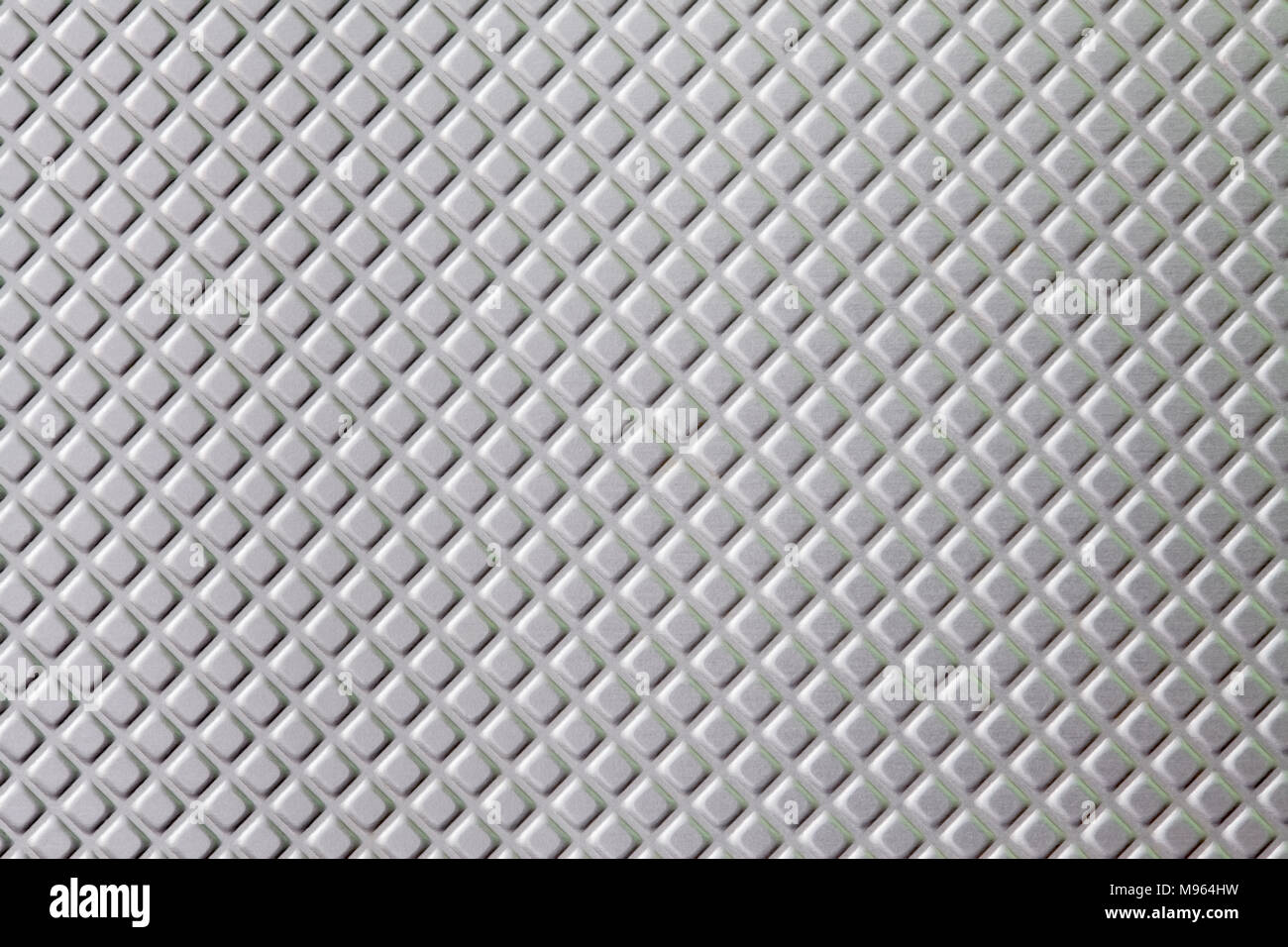 Metallic silver repeat grid pattern or background - Stock Image