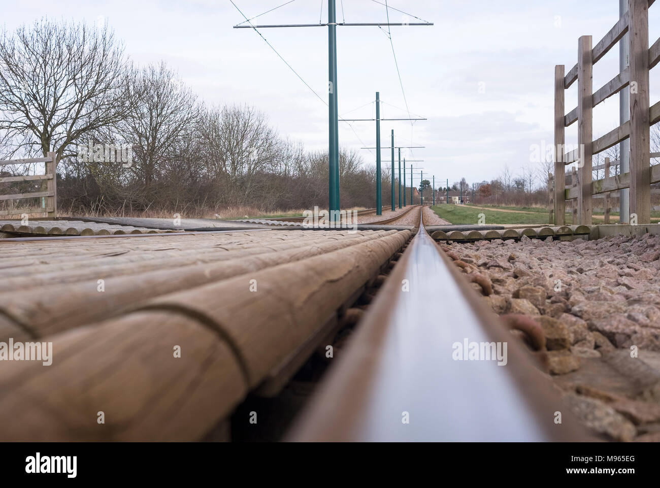 Worms eye view along a tram rail - Stock Image