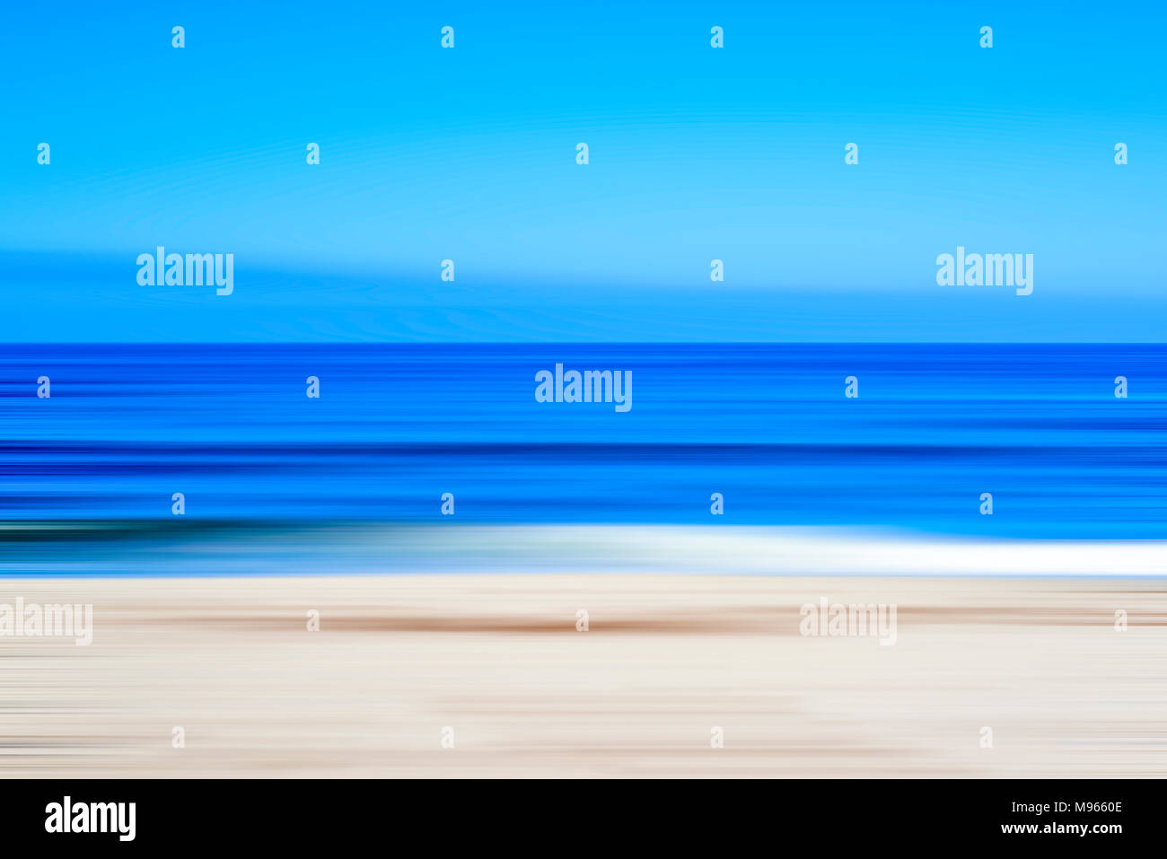 Coastal scene, ocean and beach. Motion blur effect, Impressionistic photography. - Stock Image