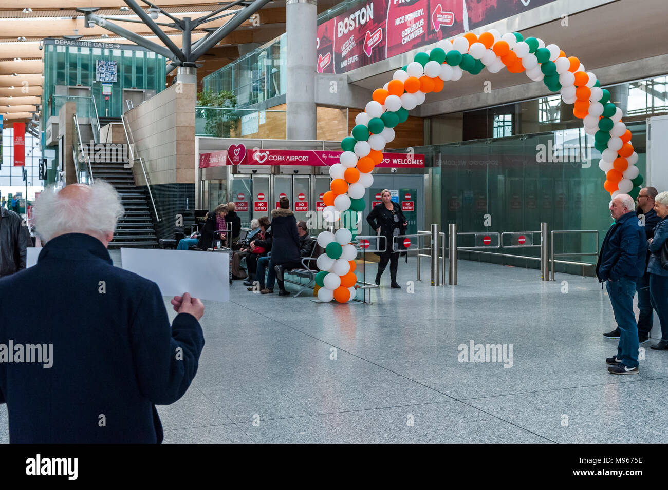 Arrivals Gate decorated for St. Patrick's Day at Cork Airport (ORK), Cork, Ireland. - Stock Image